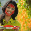 Girl with plate of colour — Stock Photo