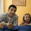 Father and daughter playing video games — Stock Photo #39452103