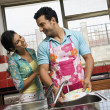 Couple washing dishes — Stock Photo #39452321