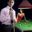 Man with cue stick posing — Stock Photo #39452573