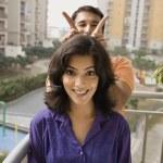 Couple on balcony — Stock Photo