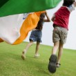 Stock Photo: Children running with IndiFlag