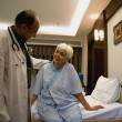 Doctor with his patient — Stock Photo #39455175