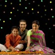 Стоковое фото: Family celebrating diwali