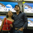 Stock Photo: Couple at TV showroom