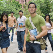 Stock Photo: College students walking together