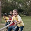Children pulling rope — Stock Photo #39456853