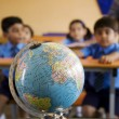 Students looking at a globe — Stock Photo #39458105