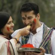 Stock Photo: Couple celebrating Holi