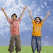 Children jumping with joy — Stock Photo #39458379