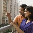 Couple on balcony — Stock Photo