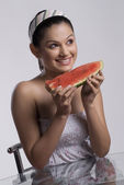 Woman holding a watermelon — Stock Photo