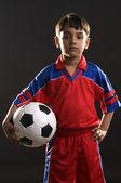 Boy holding a football — Stock Photo