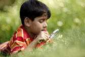 Boy with a magnifying glass — Stock Photo