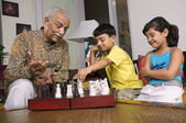 Grandfather playing with grandchildren — Stock Photo
