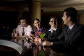 Executives at the bar — Stock Photo