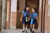School girls walking together — Stock Photo