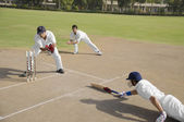 Cricketers in action — Stock Photo