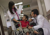 Doctors and a child — Stock Photo