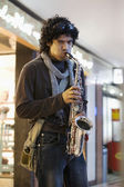Man with a saxophone — Stock Photo