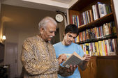 Father and son reading a book — Stock Photo