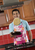 Man tossing a pancake — Stock Photo