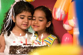 Girls with birthday cake — Stock Photo