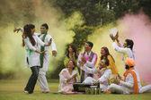 Family celebrating Holi — Stock Photo