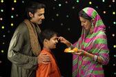 Family celebrating diwali — Photo