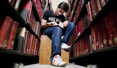 College student in the library — Stock Photo