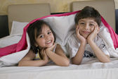 Children on the bed — Stock Photo