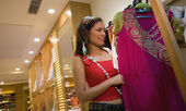 Woman selecting cloth — Stock Photo
