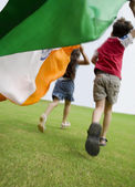 Children running with the Indian Flag — Stock Photo