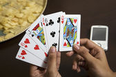 Friends playing cards — Stok fotoğraf
