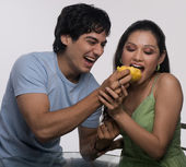 Man feeding a woman — Stock Photo
