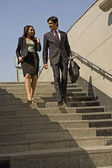 Executives climbing down the stairs — Stock Photo