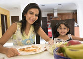 Mother and daughter having breakfast — Stock Photo
