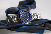 Watch along with blue tie — Stock Photo