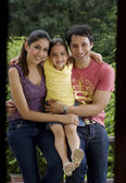 Meisje met haar ouders — Stockfoto