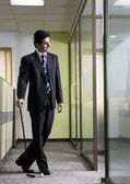 Business executive with golf club — Stock Photo