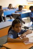 School girl at her desk — Stock Photo