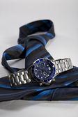 Wrist watch and tie — Stock Photo