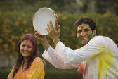 Couple celebrating Holi — Stock Photo