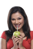 Woman sipping juice — Stock Photo