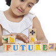 Girl playing with wooden blocks — Stock Photo #42202845
