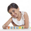 Girl playing with wooden blocks — Stock Photo #42204669