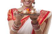 Bengali woman's hands holding pooja thali — Stock Photo