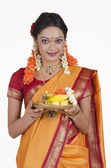 South Indian woman holding a thali — Stock Photo