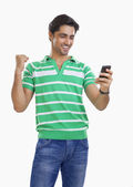 Man reading an sms and rejoicing — Stock Photo