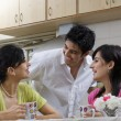 Friends having coffee in the kitchen — Stock Photo